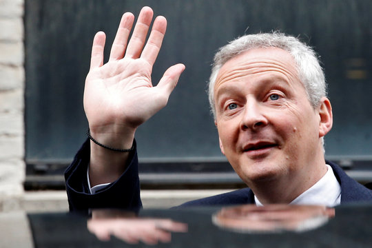 """French Finance Minister Bruno Le Maire waves after he visits the new logistic hub of """"Vestiaire Collective"""" an online marketplace to buy and sell pre-owned designer clothing and accessories, in Tourcoing"""