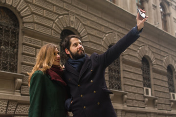 Young couple taking selfie at the street
