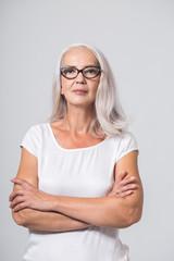 Confident senior woman with glasses