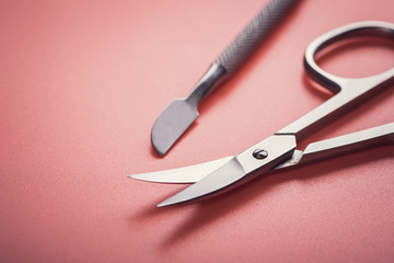 Cosmetic scissors on pink