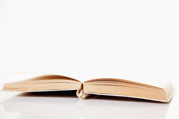 Open book on white background as a symbol of literature and knowledge.