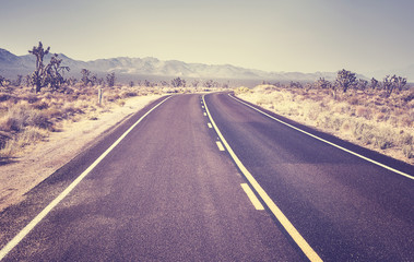 Deserted highway, retro color toned picture, travel concept, USA.