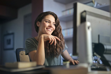 Smiling woman working at the pc