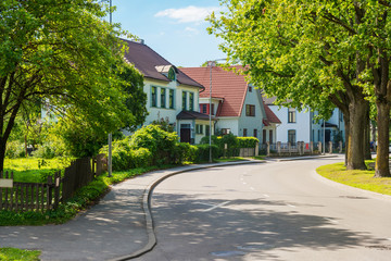 beautiful street with modern residential houses in summer sunny
