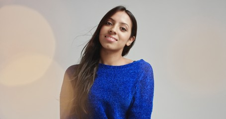 beautiful dark haired girl in a toasty fluffy sweater with lens flare on white background