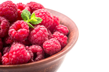 ripe raspberry on bowl isolated