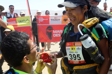 A runner gets a marriage proposal after crossing the finish line at the Marathon des Sables in Paracas