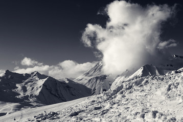 Snowdrift, ski slope and beautiful snowy mountains