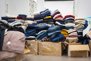 Stock clothing - A collection jeans, sweaters, jackets in modern distribution warehouse in the mall. Inventory, logistic, export concept.