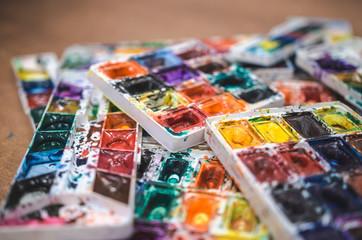 Watercolor dirty palette. Painting Studio. Soft focus