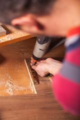 Carpenter work on wood plank in workshop