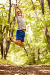 fitness, sport,  and people concept man jumping and exercise