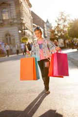 Young girl at the street with shopping bags