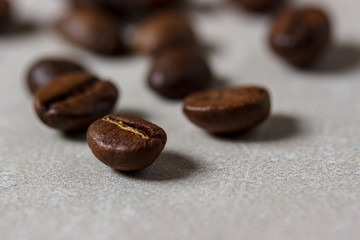 Coffee beans on gray concrete background
