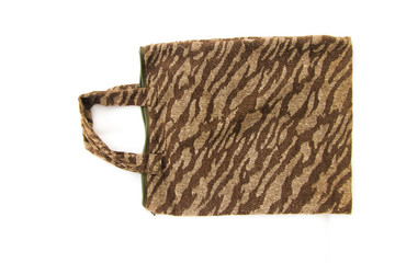 Cloth brown patterned bag on white background