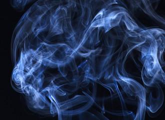 Blue smoke on black background.