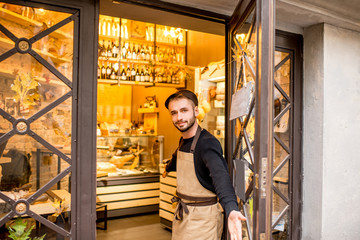 Portrait of a salesman in uniform outdoors in front of the store entrance