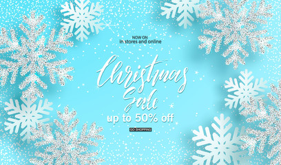 Christmas sale. Background with shiny silver snowflakes on blue background. Design for invitation, banners, ads, coupons, promotional material. Vector illustration
