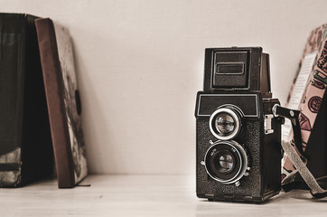 Vintage photo camera on wooden background with instagram retro filter effect