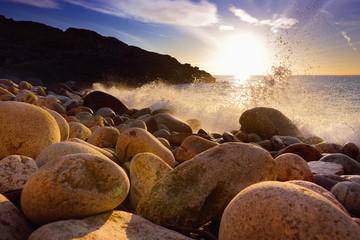 Waves breaking on a rocky beach over Porth Nanven in the Cot Valley of Cornwall, England