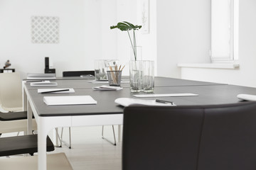 Modern office interior with large table and chairs