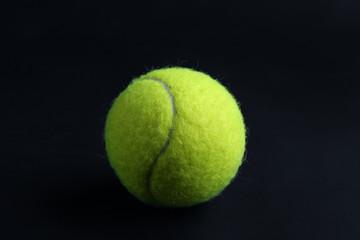 Tennis ball on black background