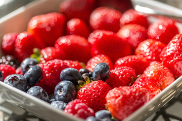 Berries of strawberries and blueberries for breakfast. Close-up.