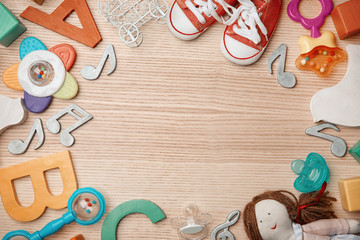 Beautiful composition with children stuff on wooden background. Baby songs concept