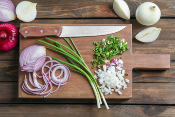 Fresh cut onion on wooden board