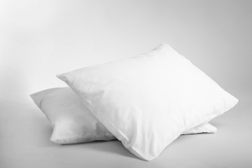 Blank soft pillows on light background