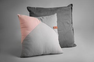 Soft pillows on light background