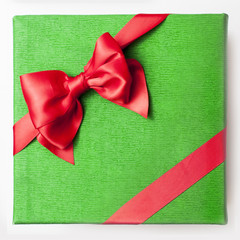 Gift box lid with red satin bow.