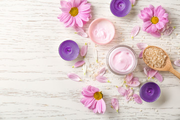Beautiful composition with jar of body cream on wooden table