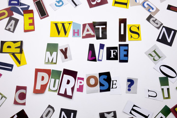 A word writing text showing concept of WHAT IS MY PURPOSE made of different magazine newspaper letter for Business case on the white background with copy space