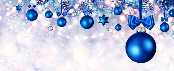 Fotomurales - Blue Christmas Balls Hanging At Fir Branches