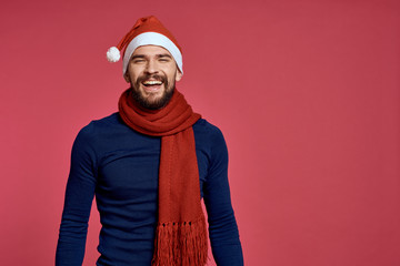 man smiling on a red background, free space for copy, christmas