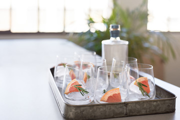 Tray of drinks cocktail glasses on table