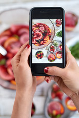 taking photo of food on mobile cell phone to share on social med