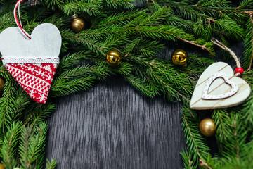 Christmas toys. Christmas background. Black background. Real tree