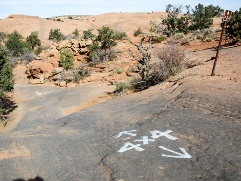 Rubber stained 4 x 4 off road marker at Slickrock recreation area in Moab, Utah
