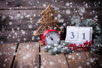 Calendar,  clock, decorative tree, berries and branches fur tree on aged  wooden background.