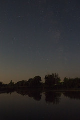 Night pond with starry sky