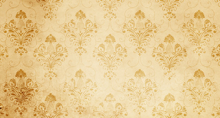 Old yellowed paper background with floral pattern.
