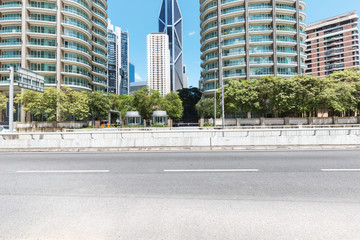 empty concrete road and modern buildings