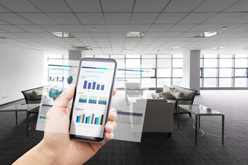 smart phone with business chart with modern lobby