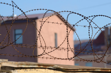 Barbed wire on the prison walls.