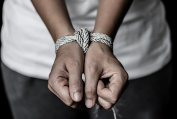 Stop violence against women, hands were tied with a rope. Violence, Terrified, Human Rights Day concept.