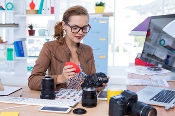 Female executive repairing a digital camera