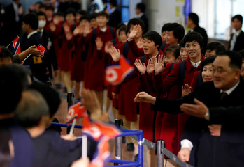 North Korea's women's national soccer team arrive for the EAFF E-1 Football Championship at Haneda international airport in Tokyo