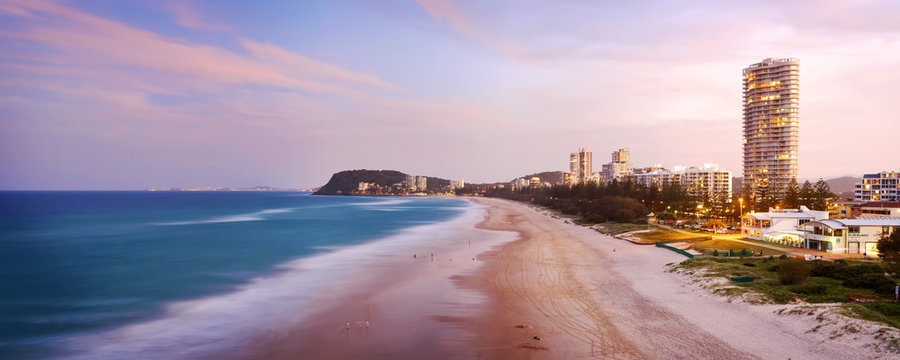Dusk over North Burleigh Heads on the Gold Coast with the Burleigh headland visible in the distance. Gold Coast, Queensland, Australia.